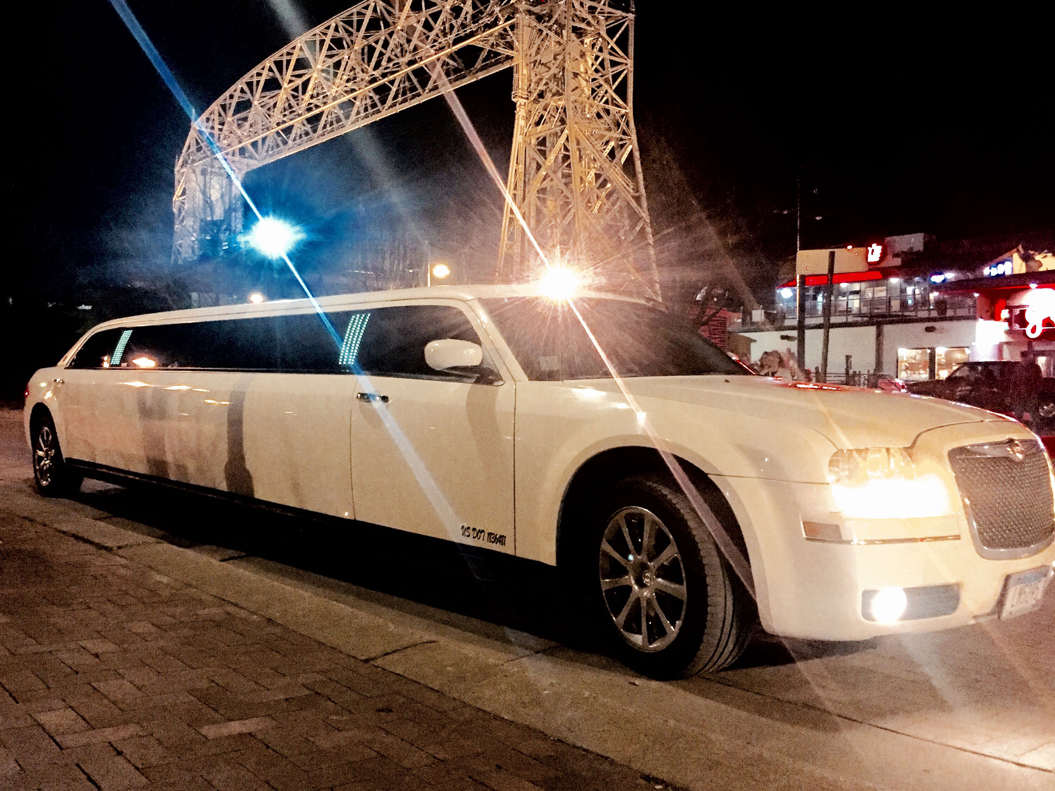 white Chrysler 300 Stretch limousine at night