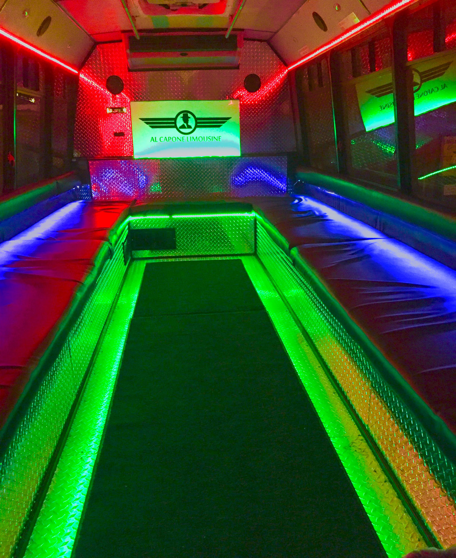 Inside one of Al Capone Limousine Service Party Bus with all LED lights lit up